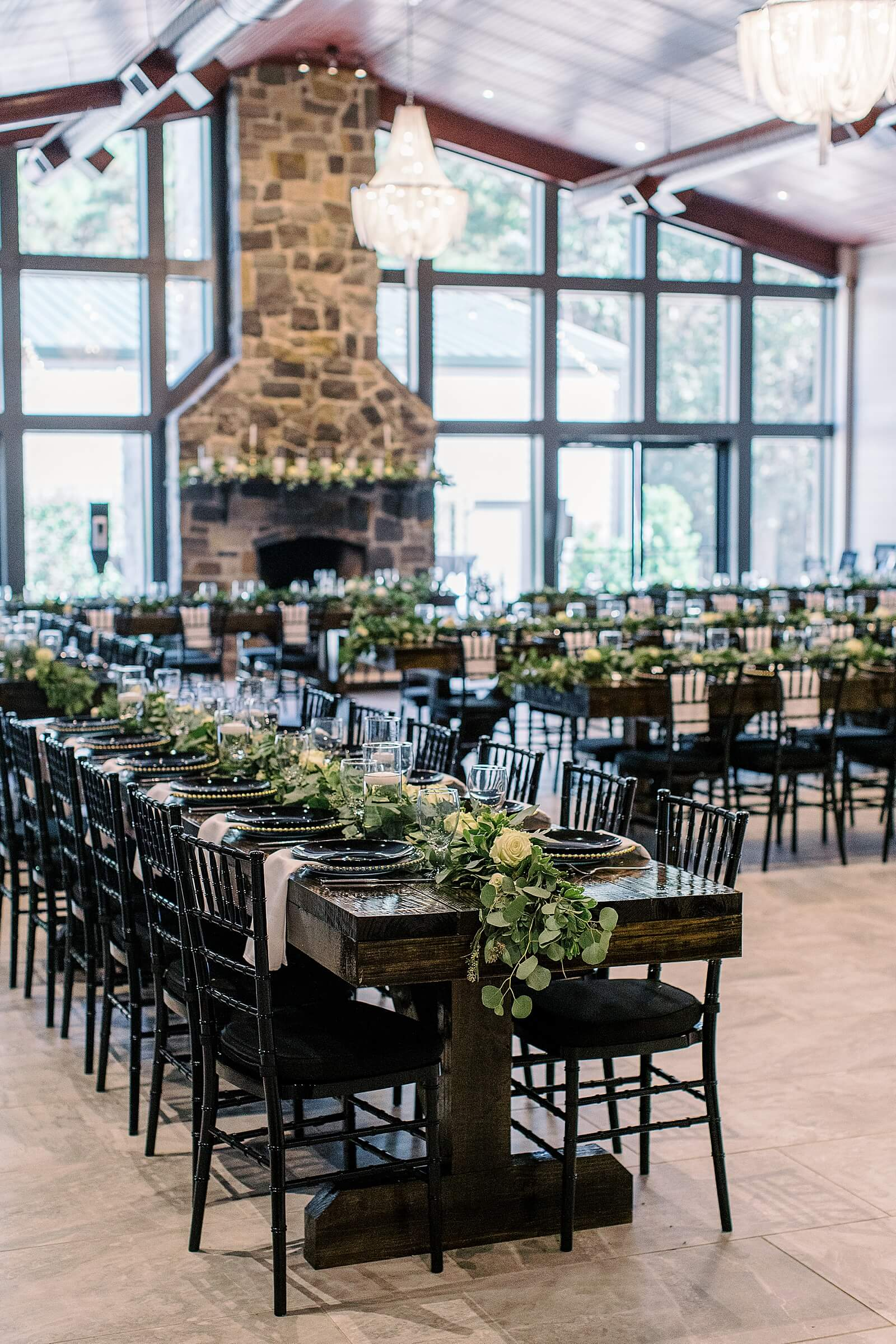 Wedding table setup with greenery at one of the elegant wedding venues in Houston The Annex