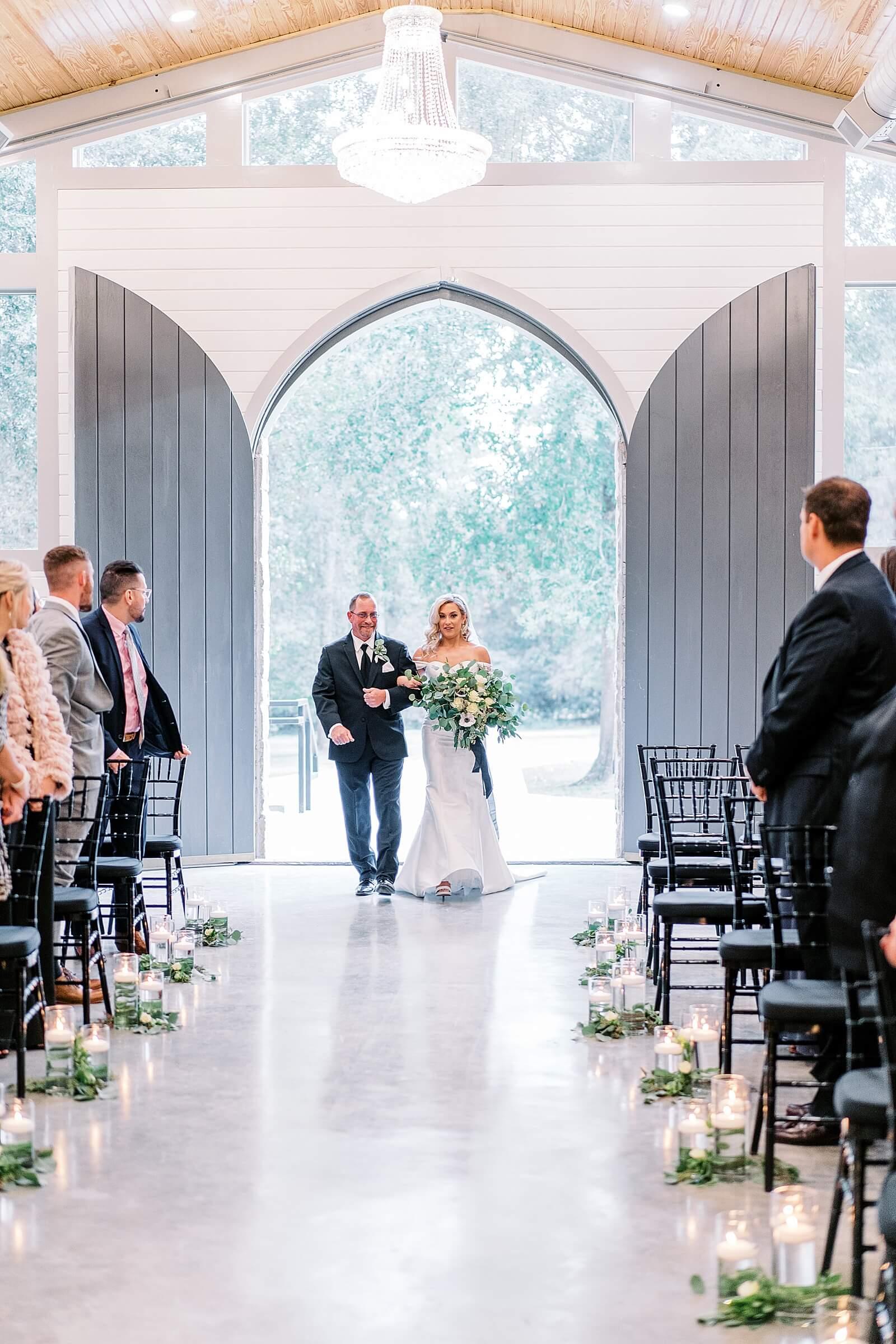 Elegant bride walking down the aisle at Houston wedding chapel The Annex