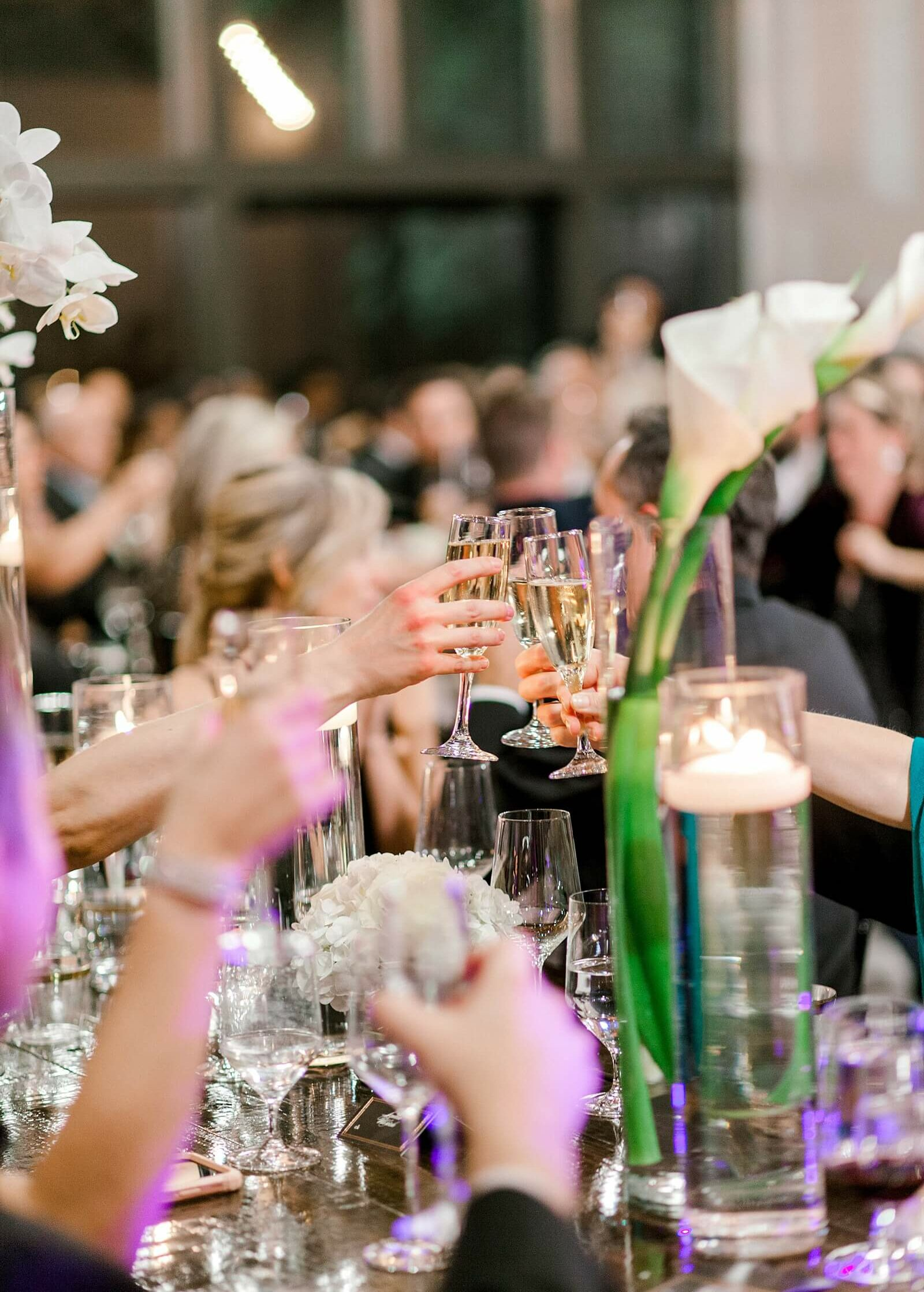 Guests toast with champagne at The Annex Houston wedding venues