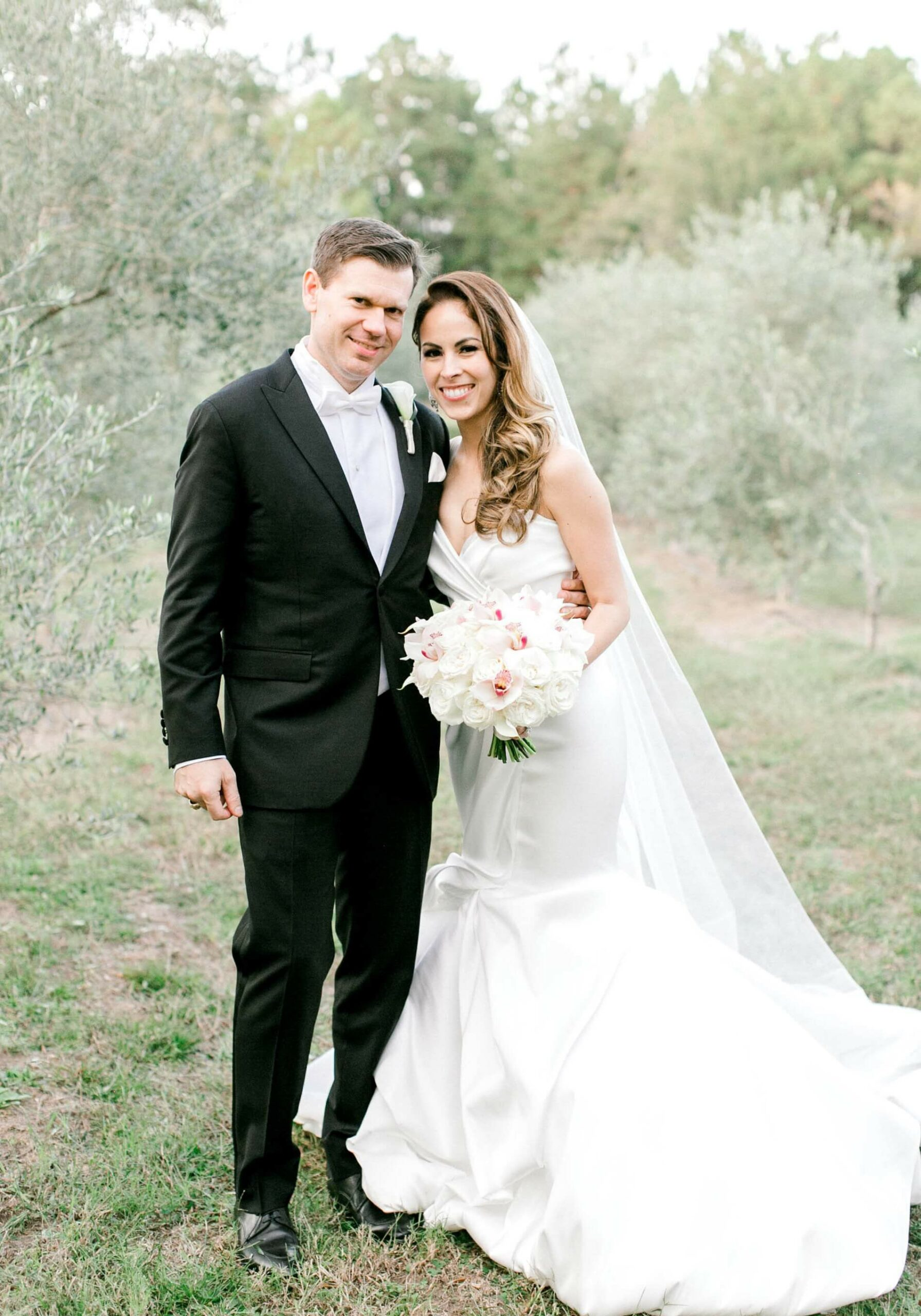 Newlyweds in olive tree orchard after wedding ceremony at The Annex wedding venue