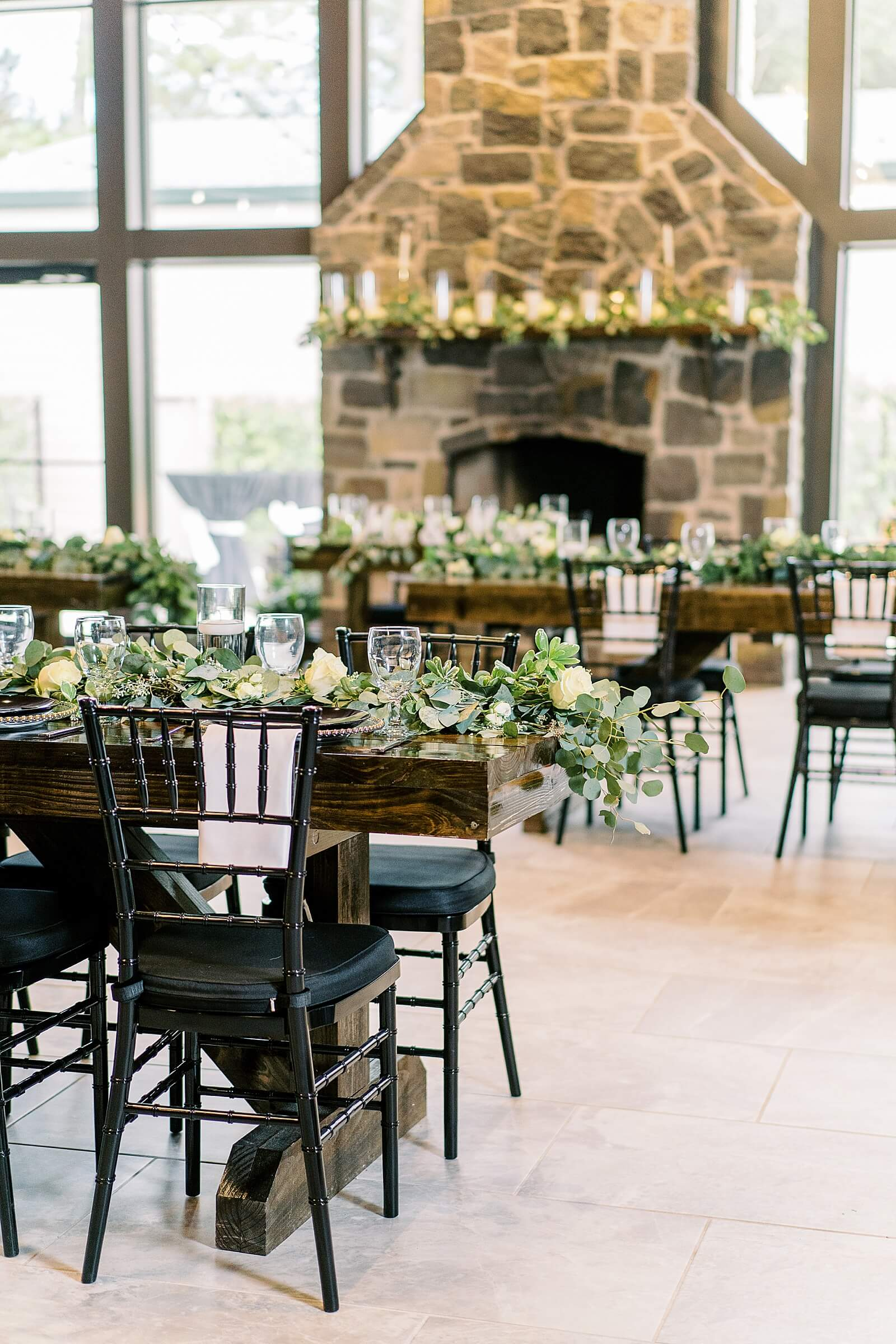 Beautiful farmhouse table with greenery runner inside one of the unique wedding venues in Houston The Annex