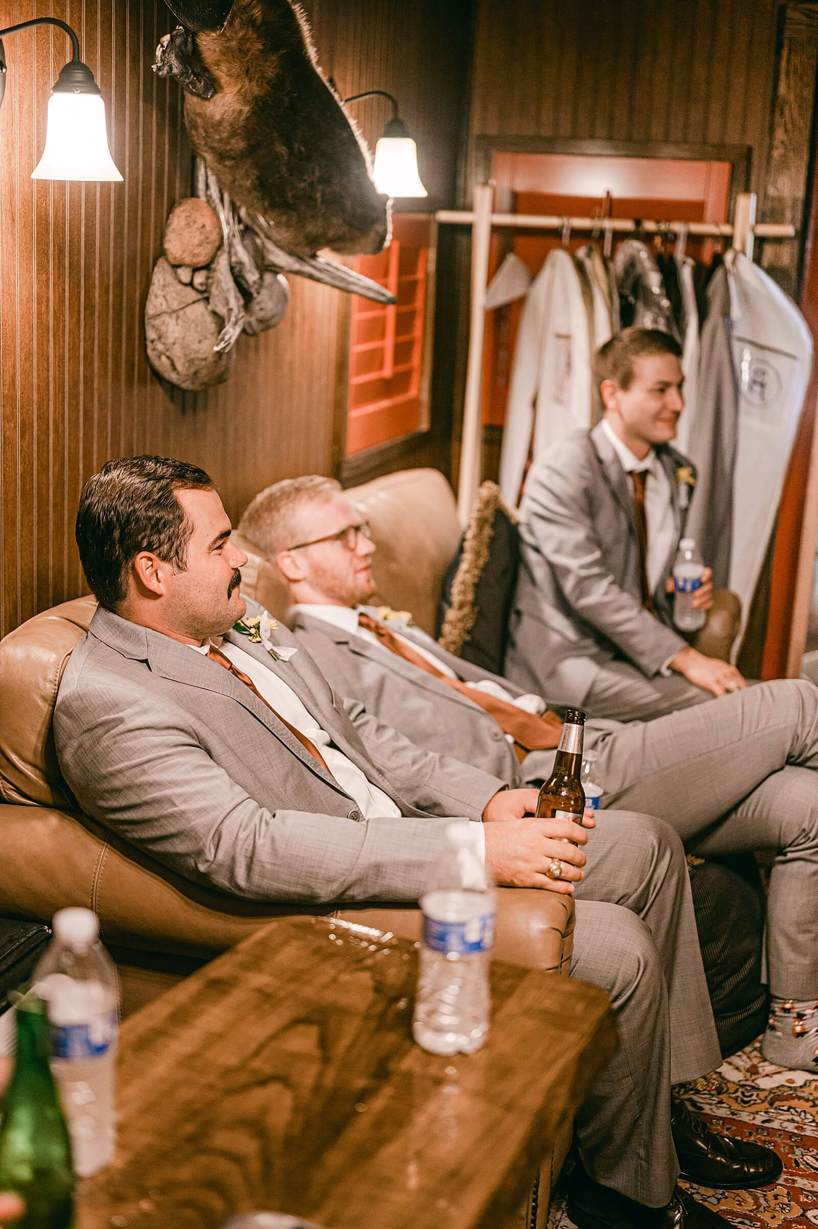 Groomsmen hang out inside groom's room at The Annex wedding venue near College Station
